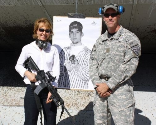 Gabby Giffords grinning with gun and target