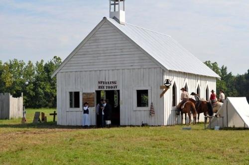 Cowboys outside church