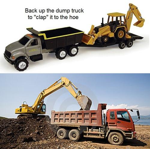 Dump truck pulling backhoe
